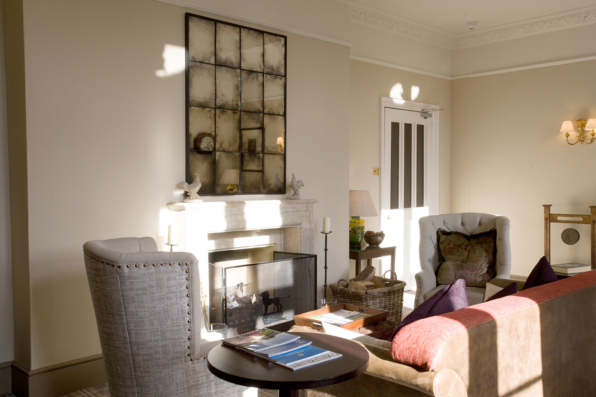 Hampshire b and b with an open fire place in a bright lounge