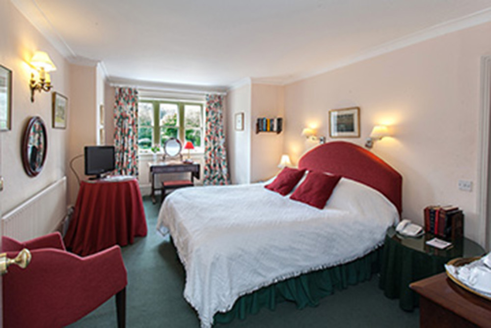 Petersfield B&B with a wine coloured double bed