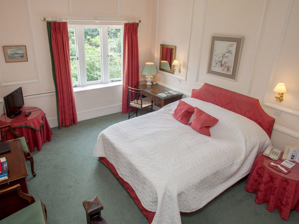 Double bedroom, pick and white at Hampshire's best bed and breakfast hotel