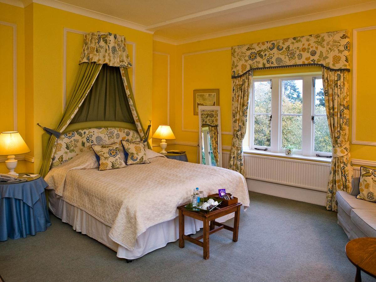 Yellow and blue decorated bed and breakfast room in Hampshire