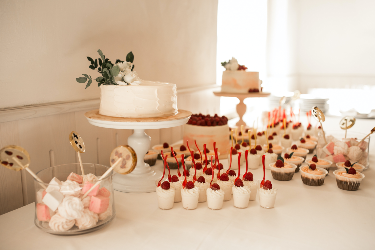 Self catering wedding venue with a delicious assortment of sweet treats and a wedding cake