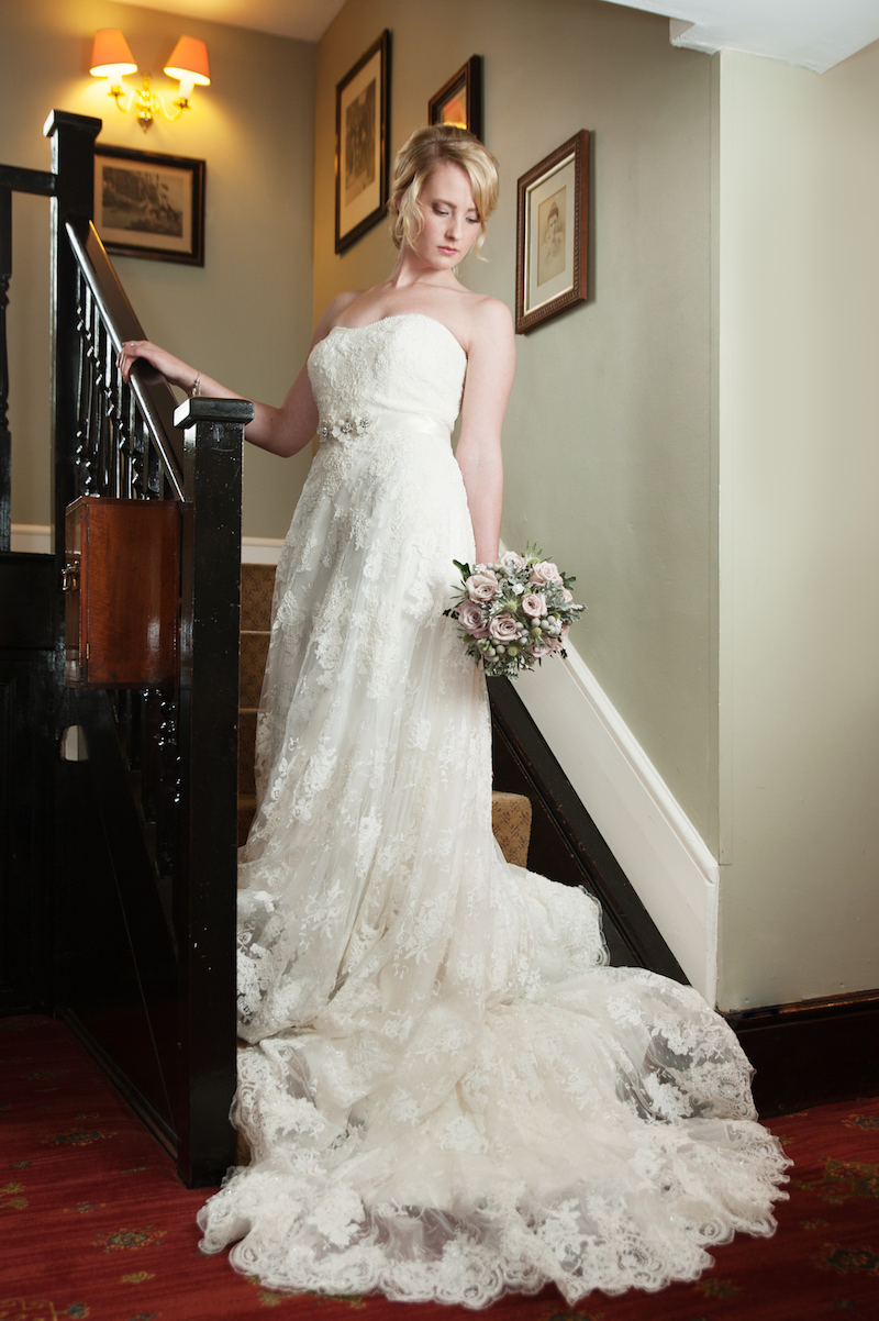 Bride on the stairs at our wedding venue to hire