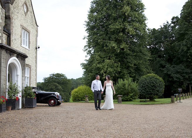 Wedding venue in Petersfield with a bride and groom in front of Langrish House